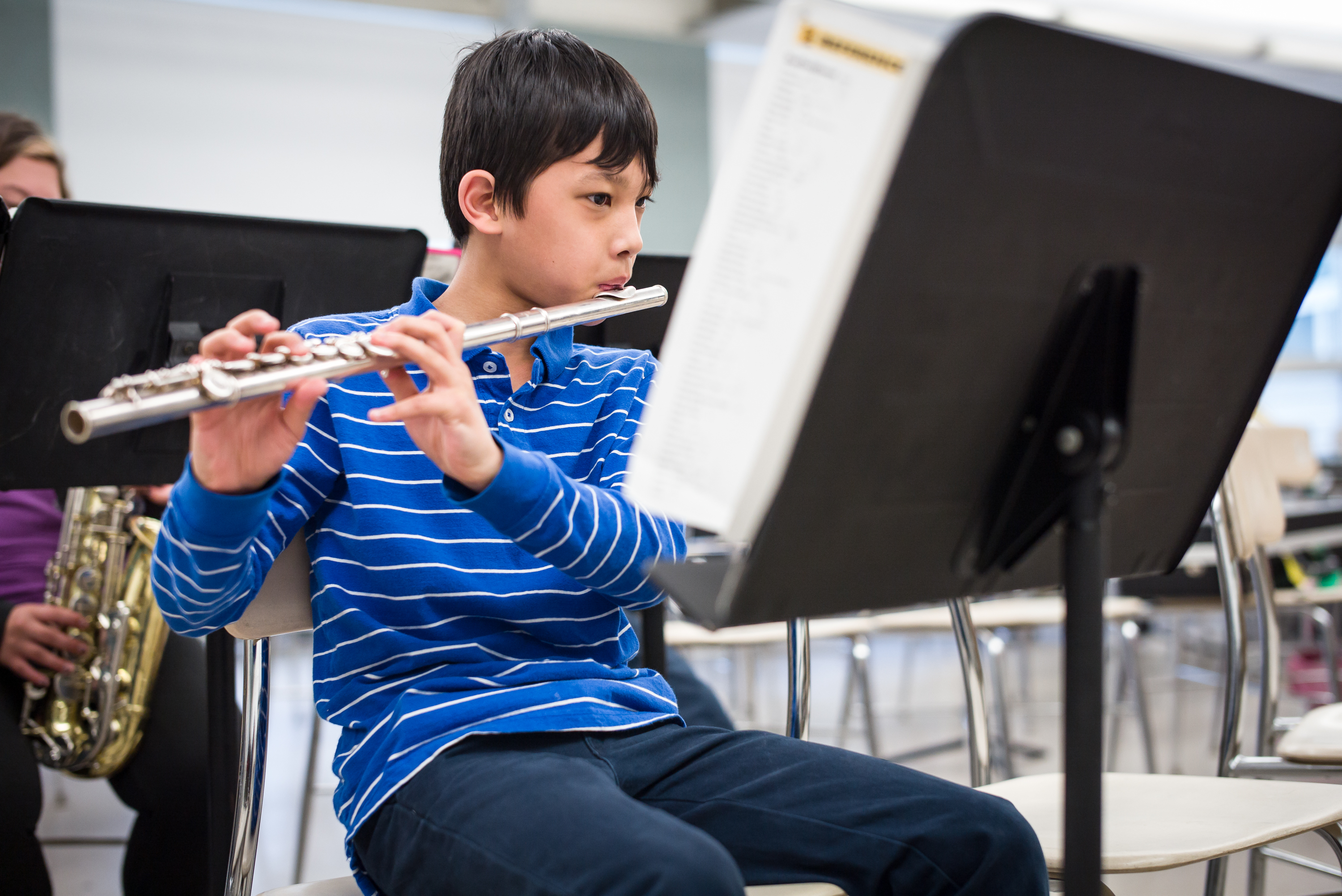 Elementary School Student Playing the Flute