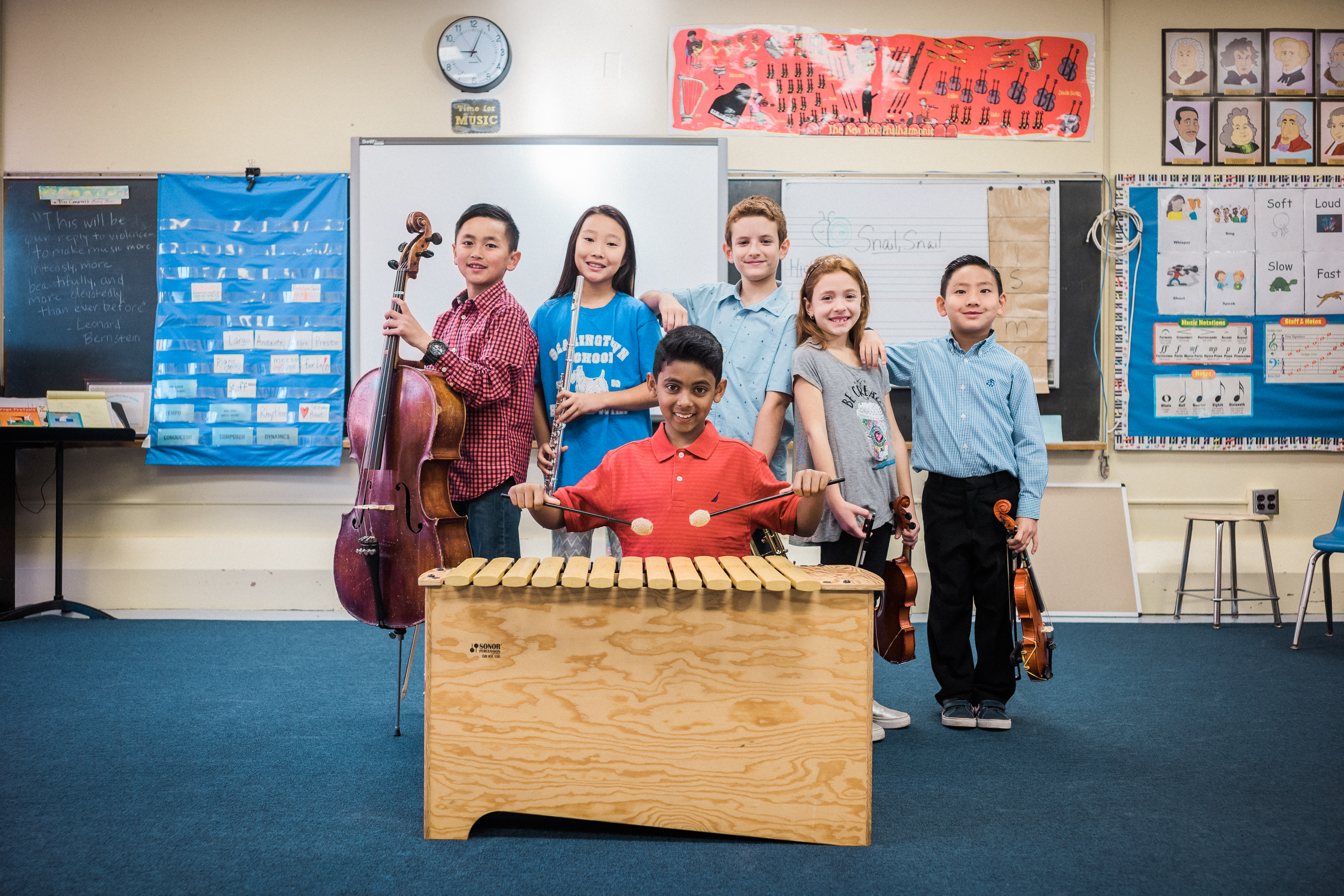 An image showing children in a music classroom reaping the benefits of music education