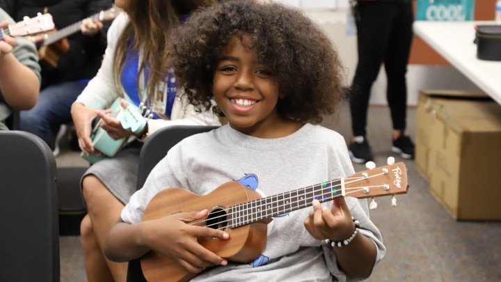 middle school child learning the uke during NAMM's Day of Service at The 2020 NAMM Show