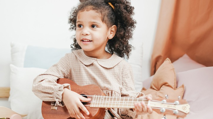 Girl Playing the Ukulele