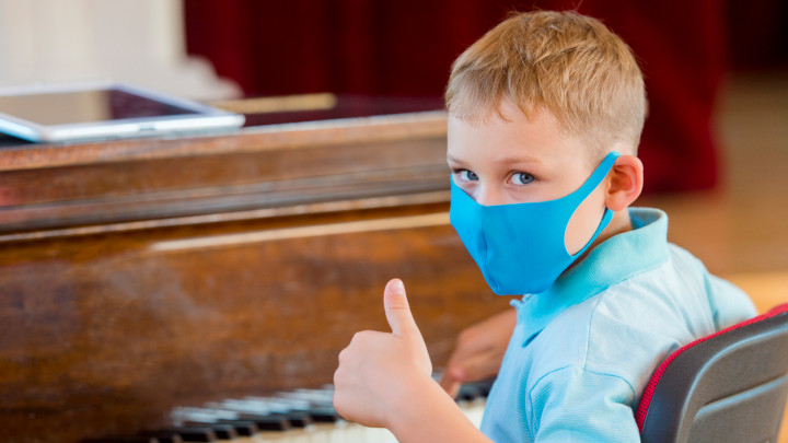 Masked piano student